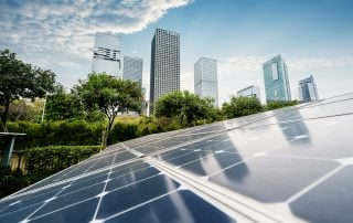 solar panel plant with urban landscape landmarks,Ecological energy renewable concept.